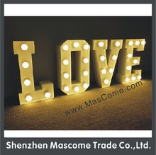 LED white bulbs lighted up 50cm height LOVE sign the frame have been paint to white color