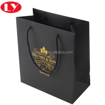 Gold logo matt black paper shopping bag with twist string