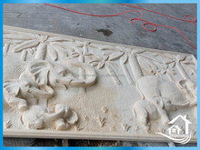 Lively sandstone animal carving