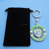 Metal Rotating keychain with hockey logo packed with velvet bag