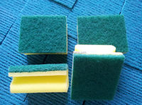 Household abrasive scouring pad material
