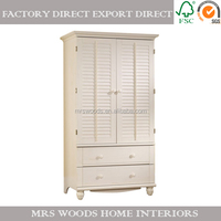 french provincial wooden armoire in antiqued white