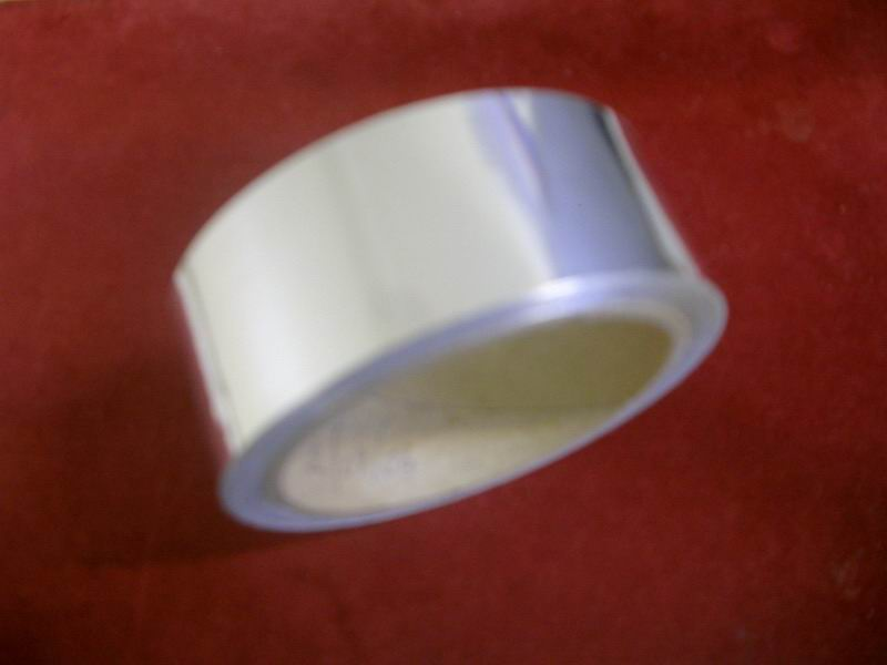 Aluminium Tape coated with pressure adhesive system.