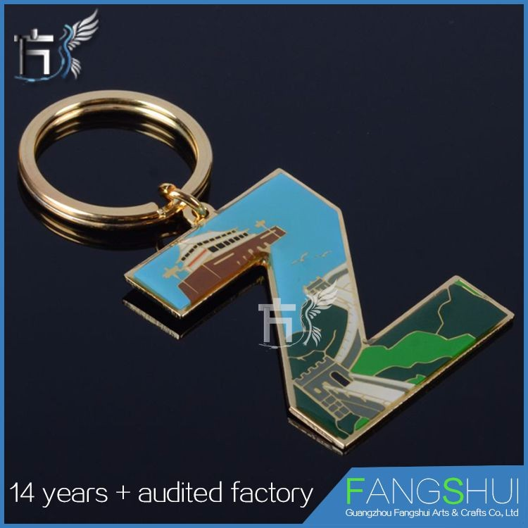 Printed metal key chain of letters