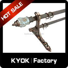 KYOK New design lotus resin curtain rod finials, double curtain rod copper color hot selling, plating curtain pole swivel supply