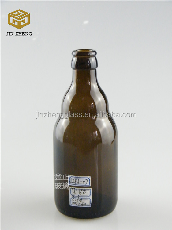 330ml dark amber open beer bottle with fridge magnet