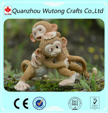 Custom Home Decoration Resin Monkey Sitting on Stone Figurine Supplier