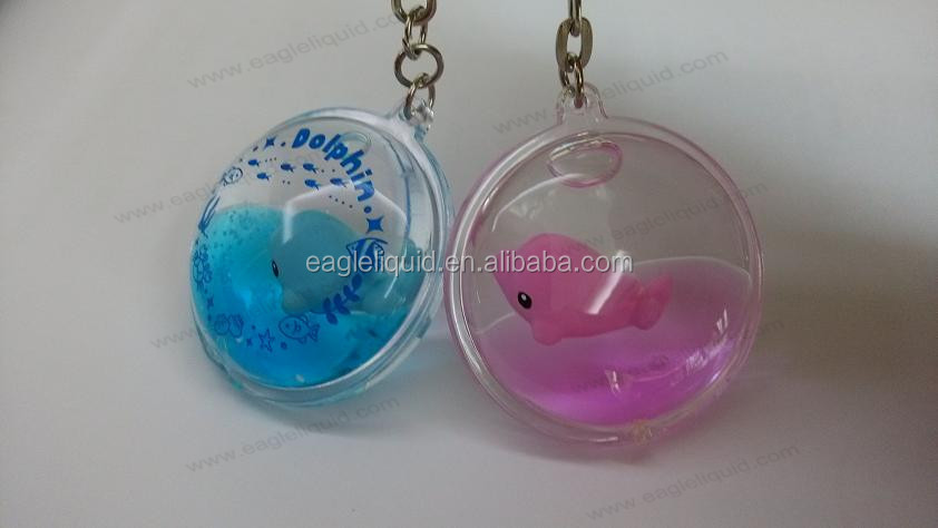 oil liquid keychain with blue pink dolphin floater