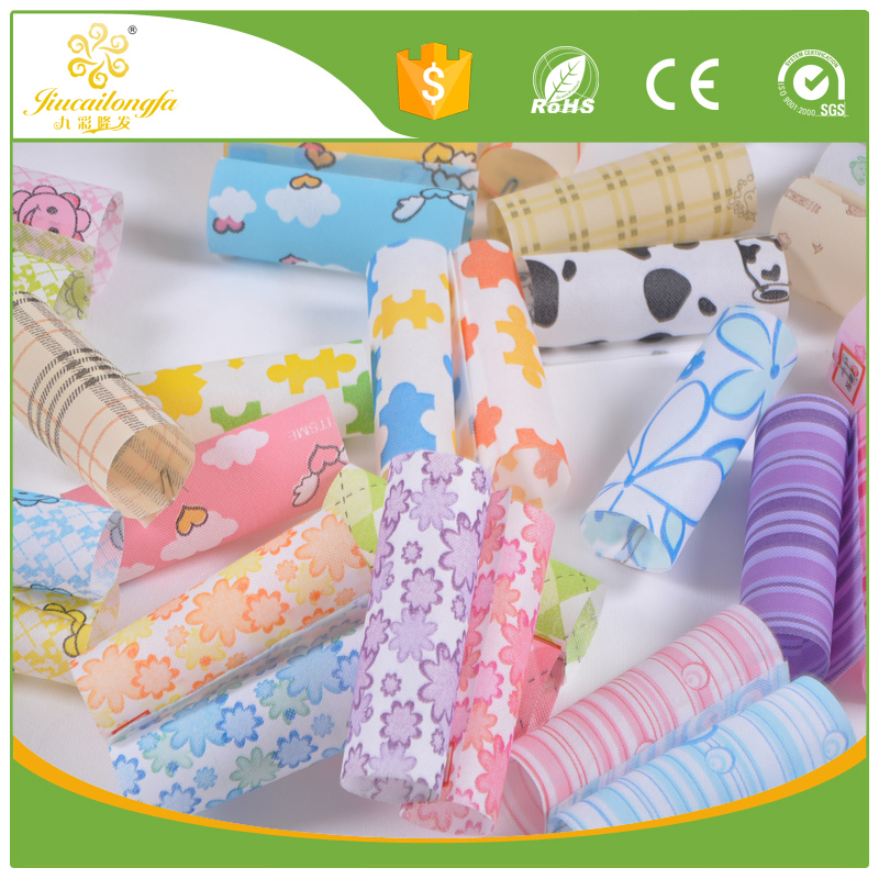 Eco friendly biodegradable fashion pattern pp spunbonded non-woven fabric, cheap price flower bouquet wrapping,bags and boxes