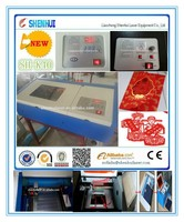 SH-K40 40W CO2 laser cutter engraver with up down laser head slatted table with honeycomb skype:liu.cnlaser