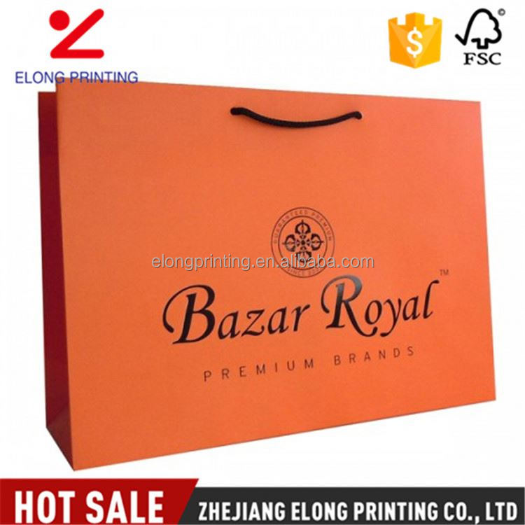 Factory sale trendy style orange red handle shopping hard kraft paper bag