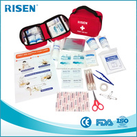 red first aid kit for treating minor emergencies cut,car,travel