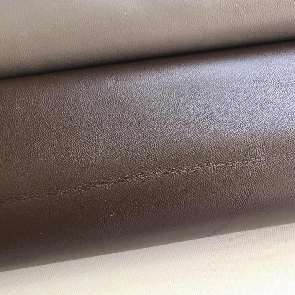 0.6-0.8 mm Thickness In Stock Grain PU Coated Covering Material Leather