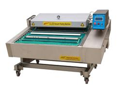 Continious vacuum packaging machine with conveyer belt