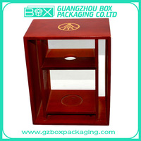 red wooden wine display box