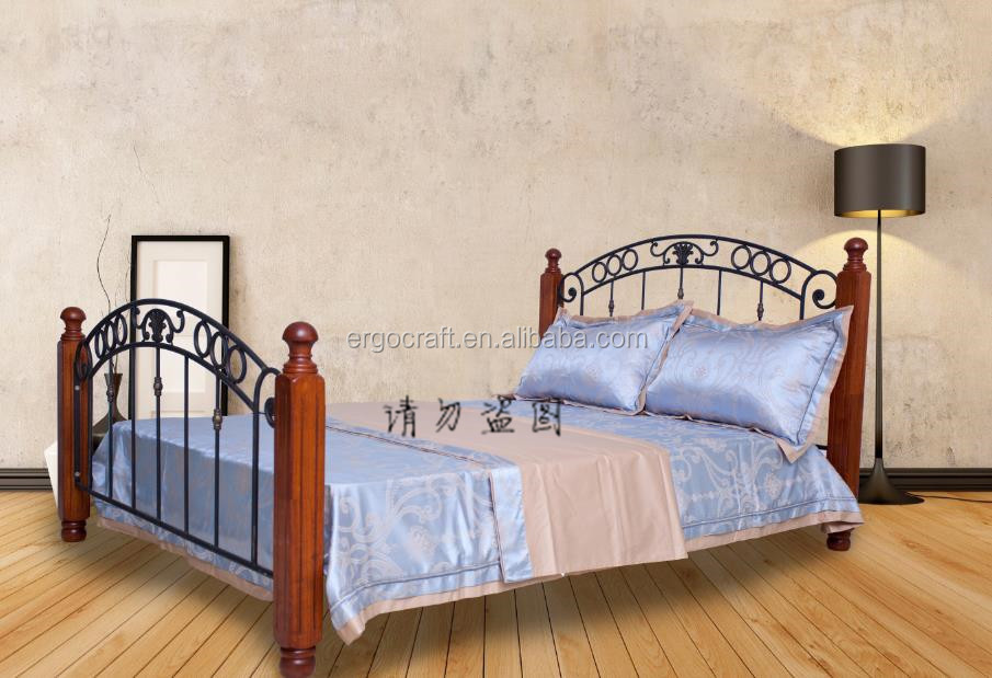 wood post wrought iron bed