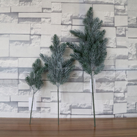 Plastic white pine tree branch flocked