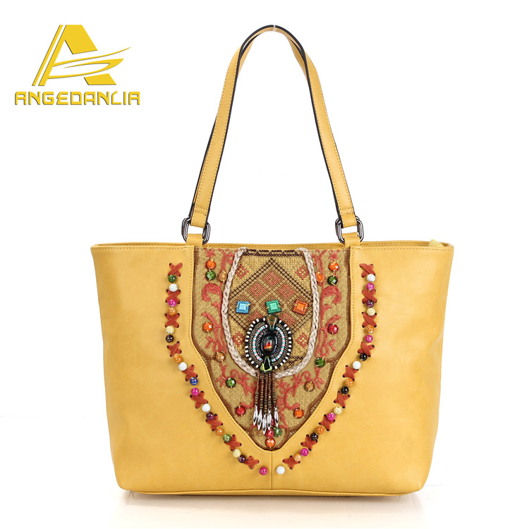 2016 fashionable design promotional ethnic style yellow color leather handbags