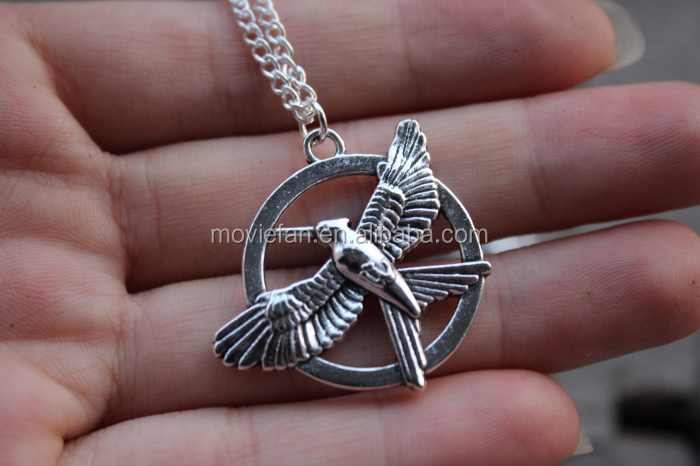 The Hunger Games Catching Fire Movie Necklace in bronze tone jewelry silver antique jewelry gift