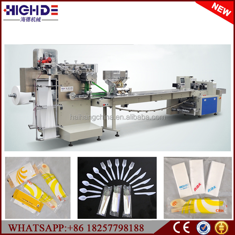 automatic packaging machine paper tissue napkin plastic fork spoon feeder flowpack manufacture