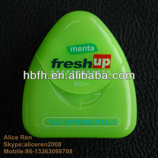 colored green dental floss