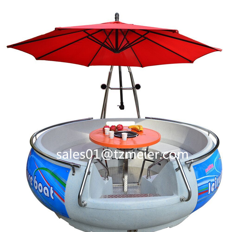 Round electric motor boat with bbq grill