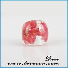 Red resin ring pressed flower plastic resin ring, Bow rings and Resins
