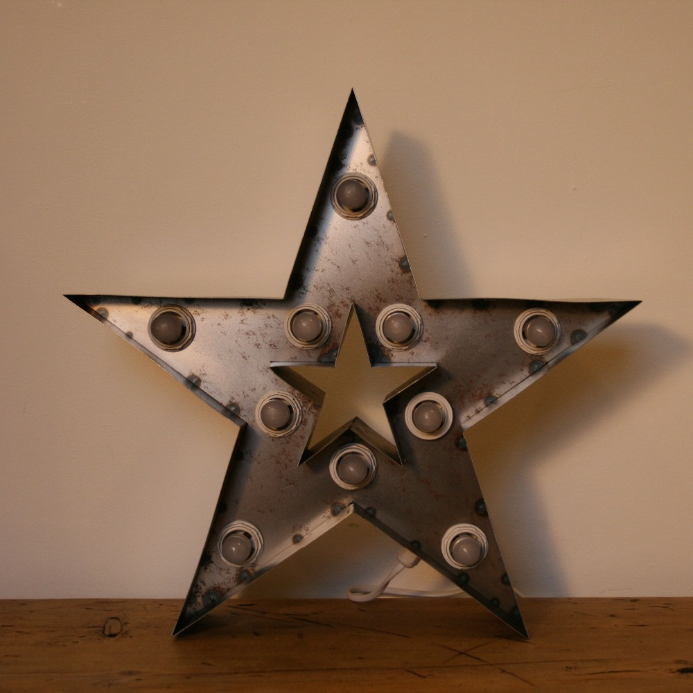 Intricate metal star custom metal <strong>signs</strong> in retail shop for display showroom