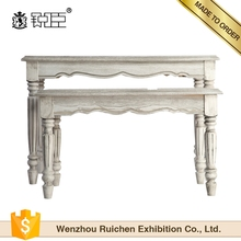 Simple style weathered white wood clothing display table