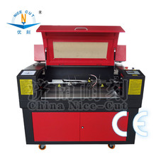 NC- 6090 Laser cutting machine for 25.4 mm tape and can cut 3 slots into pieces