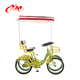 Red 4 person surrey bike with fender/fun pedal riding on road/parents and kids tandem bicycle