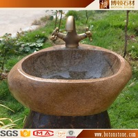 smooth polished finish inside stone wash vessel sink with river stone