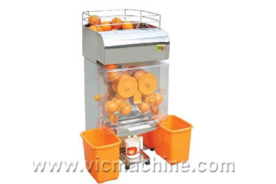 Orange juicing machine