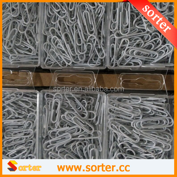 SORTER Tin box within white fancy paper clips