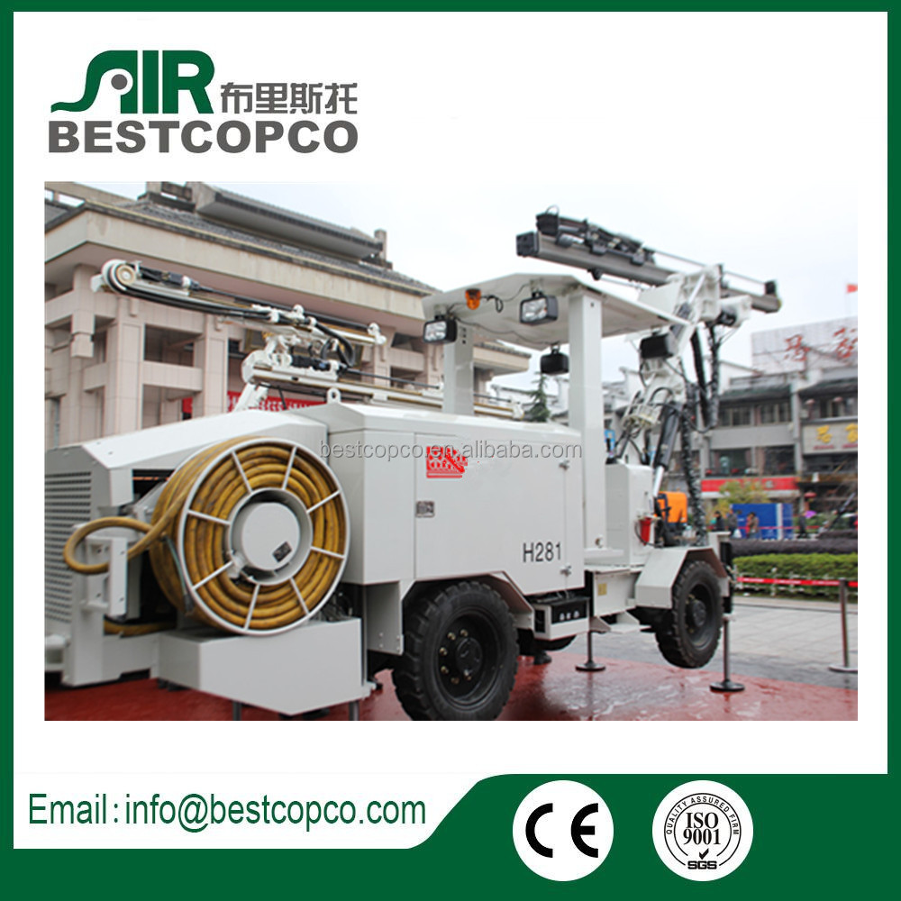 Integrated portable auger drilling rig with cab