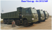 Hot sale China left hand driving sinotruk howo 6x4 dump truck low price for sale 371hp red color zz3257n3447a1