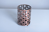 11A761 Round copper metal tealight holder with star and blank hollow out shape