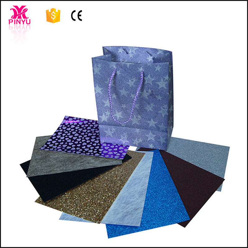 Different colors and logo handels gift shopping kraft paper bag from shanghai china