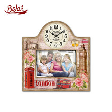 Red london bus and telephone booth design stylish photo frame with clock