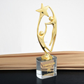 star shape metal award with clear crystal base