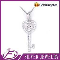 Fashionable imitation diamond rhodium plated sterling silver lock and key pendant