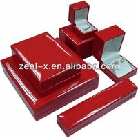 High quality glossy red wooden jewelry box with white velvet inner