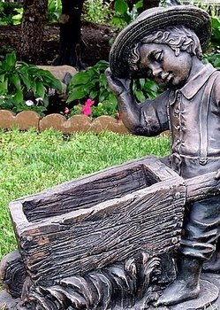 Statue - Little boy with wheelbarrow planter / statue