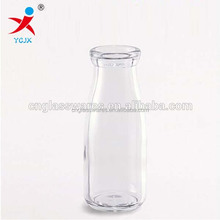 SMALL GLASS MILK BOTTLE