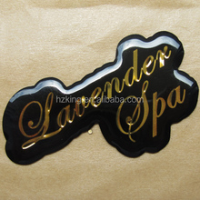 Customized embossed gold foil domed label
