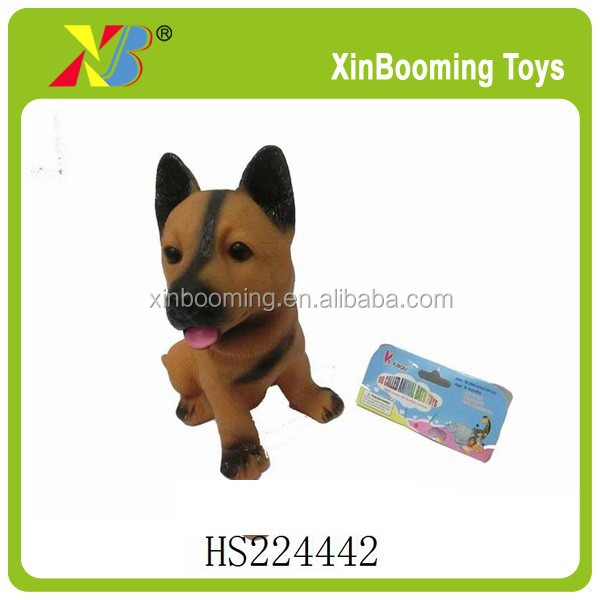 Small rubber dog toy with BB wlistle