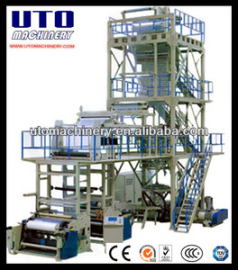 Multilayer co-extrusion take up rotary film blowing machine
