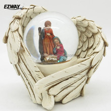 Holy family religious sculpture led snow globe