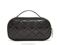 Black mesh cosmetic bag with handle
