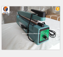 SF-300 hand impulse plastic bag heating portable table type sealing machine